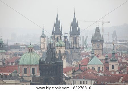 Tyn Church and the Old Town Hall in Old Town Square viewed from Petrin Hill in Prague, Czech Republic.