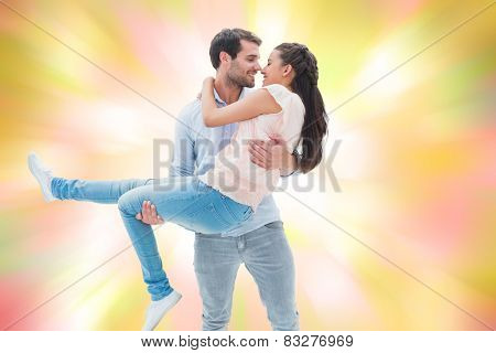 Attractive young couple having fun against girly pink and yellow pattern