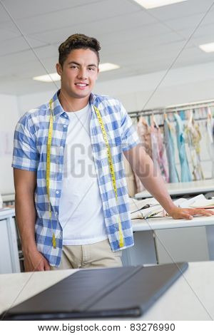 Fashion student posing with meter around his neck at the college