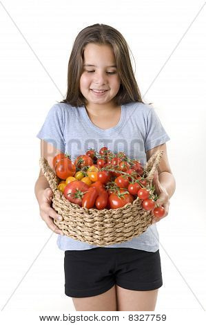 Girl Holdin A Basket Of Tomatoes