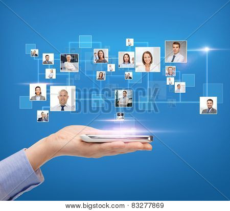 business, people, technology and communication concept - close up of woman hand with smartphone over blue background with icons of contacts