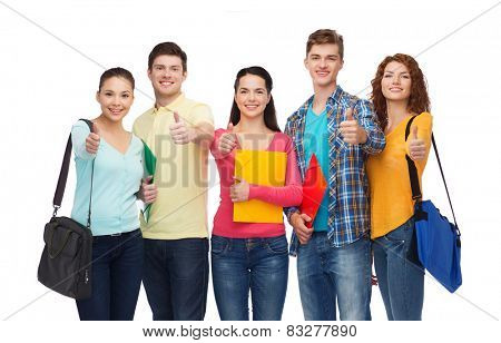 friendship, youth, education and people concept - group of smiling teenagers with folders and school bags showing thumbs up