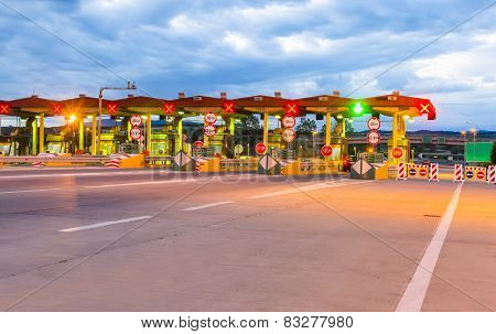 Toll booth station on a highway at sunrise