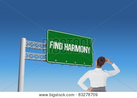 The word find harmony and businesswoman scratching her head against blue sky
