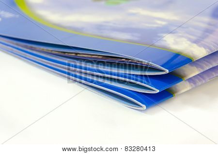 Stack of magazines brochures isolated