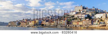 Panorama of the Ribeira District of the city of Porto, Portugal, and the Douro River seen from the city of Vila Nova de Gaia during sunset. Unesco World Heritage Site