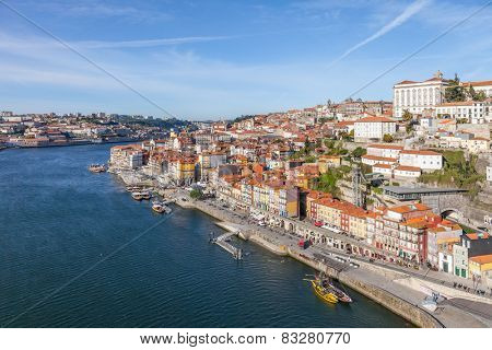 Porto, Portugal. December 29, 2014: The typical colorful buildings of the Ribeira District and the Douro River in the city of Porto, Portugal. Unesco World Heritage.
