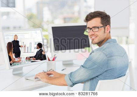 Businesswoman reporting to sales in a seminar against side view portrait of a male artist using computer