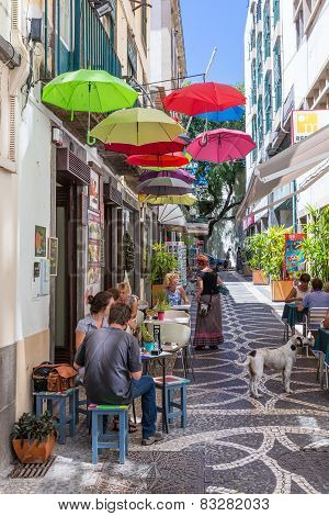 Tourists Sitting At The Terrace Of A Small Restarant In Funchal, Madeira Island