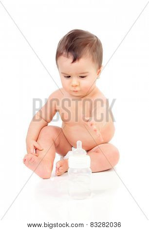 Cute hungry child extending his arms to catch the bottle isolated on white background