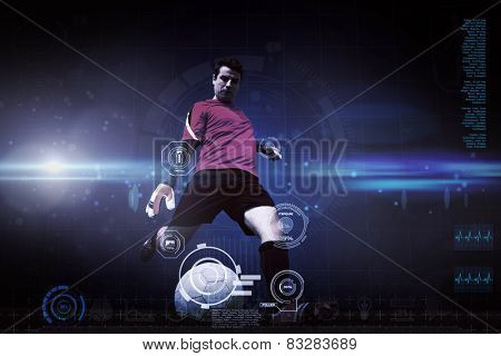 Goalkeeper kicking ball against blue dots on black background