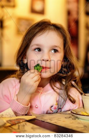 Adorable Little Girl At Cafe