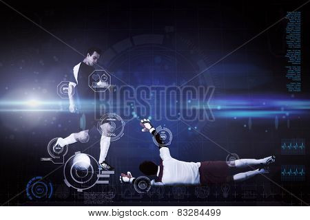 Football players tackling for the ball against blue dots on black background