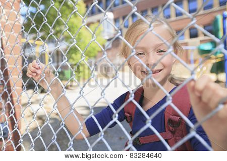 A smiling little girl at school playground