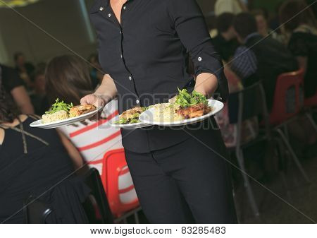 A Young waitress with plate on his hand