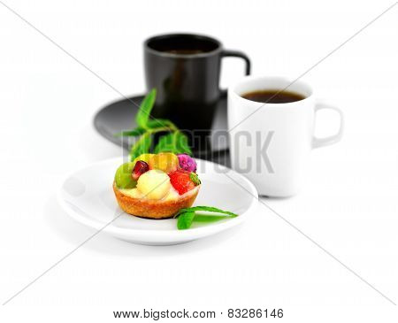 Small Fruit Cake And Two Cups Of Coffee