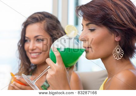 Attractive Young Woman Drinking At Happy Hour With A Friend