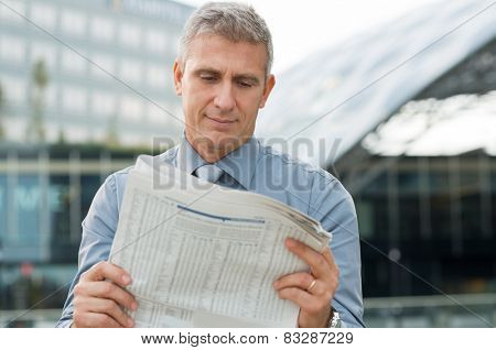Closeup Of A Stockbroker Reading Stock Price