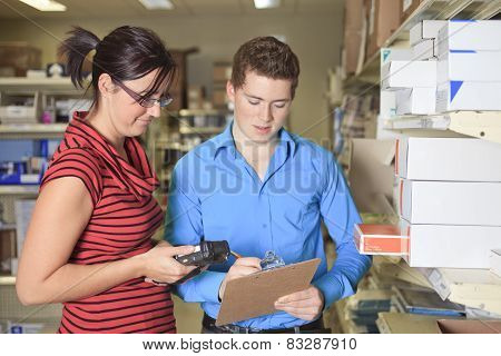 A Pretty warehouse manager checking the inventory