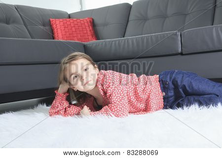 A 8 years old child laying down at home alone
