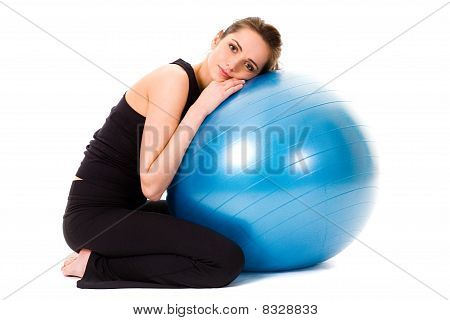 Young Tired, Very Attractive Female With Blue Fitness Ball, Isolated On White