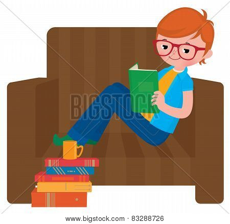 Child Boy Reading A Book Sitting In A Chair