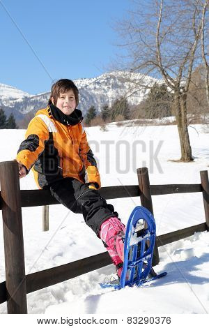 Child With Snowshoes In The Mountains
