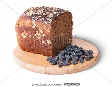 Unleavened Bread With Seeds On Wooden Board With Raisins