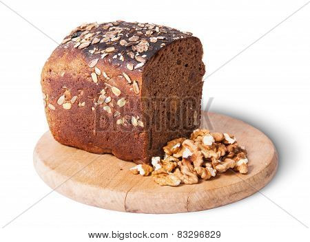 Unleavened Bread With Seeds On Wooden Board With Nuts