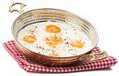 image of copper  - Fried egg in copper egg pan isolated on white background - JPG