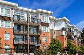 image of row houses  - Modern apartment building in sunny day against blue sky - JPG