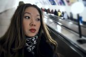 picture of escalator  - Real portrait of Asian girl on the escalator - JPG