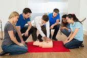 foto of resuscitation  - First Aid Instructor Showing Resuscitation Technique On Dummy - JPG