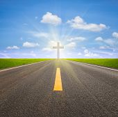 stock photo of crucifix  - Asphalt road and crucifix with blue sky background - JPG