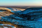 foto of ravines  - abstract hills and ravines in winter at sunset - JPG