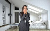 stock photo of shock awe  - Shocked Young Businesswoman in Black Corporate Attire Standing at the Bedroom with Wide Open Eyes and Hands on the Face - JPG