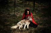 image of little red riding hood  - red riding hood and the wolf outdoor in the wood - JPG
