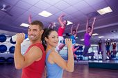 foto of zumba  - Composite image of fit man and woman smiling at camera together - JPG