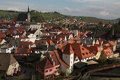 stock photo of bohemia  - St Vitus Church over tiled roofs in Cesky Krumlov - JPG