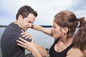 picture of shoulders  - Woman assists to man with injured shoulder - JPG
