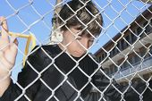 picture of playground school  - A sad boy on a school playground closing - JPG
