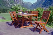 stock photo of lawn chair  - table and chairs standing on a lawn at the garden norway - JPG