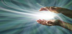 picture of wicca  - Parallel female hands with a swirling light burst between on a blue energy field background - JPG