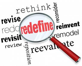 foto of overhauling  - Magnifying glass on the word Redefine and related terms such as revise - JPG