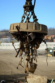 stock photo of scrap-iron  - Electromagnetic pull scrap metal in recycling center - JPG