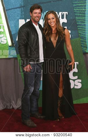 NASHVILLE, TN-JUN 10: Veteran Noah Galloway (L) and fianc�© Jamie Boyd attend the 2015 CMT Music Awards at the Bridgestone Arena on June 10, 2015 in Nashville, Tennessee.