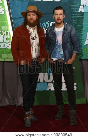 NASHVILLE, TN-JUN 10: John Osborne (L) and TJ Osborne of The Brothers Osborne attend the 2015 CMT Music Awards at the Bridgestone Arena on June 10, 2015 in Nashville, Tennessee.
