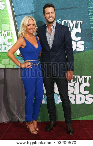 NASHVILLE, TN-JUN 10: Singer Luke Bryan (R) and wife Caroline Boyer attend the 2015 CMT Music Awards at the Bridgestone Arena on June 10, 2015 in Nashville, Tennessee.