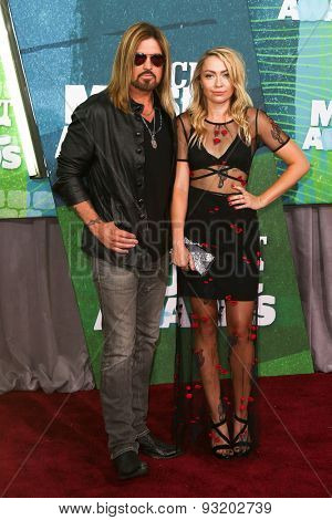NASHVILLE, TN-JUN 10: Singers Billy Ray Cyrus (L) and daughter Brandi Cyrus attend the 2015 CMT Music Awards at the Bridgestone Arena on June 10, 2015 in Nashville, Tennessee.