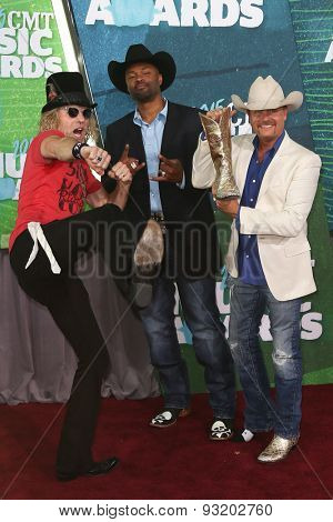 NASHVILLE, TN-JUN 10: (L-R) Big Kenny, Cowboy Troy and John Rich of Big & Rich attend the 2015 CMT Music Awards at the Bridgestone Arena on June 10, 2015 in Nashville, Tennessee.